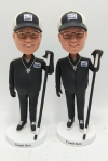 Link for one Coach Ken bobble head