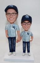 Father and son bobble head dolls with NY hats