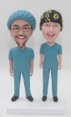 Custom doctor bobbleheads in scrubs and surgical cap
