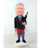 bagpipe player in Scotland skirt bobble head doll