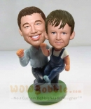 Father and Son cheered bobbleheads