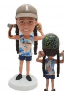 Personalized girl bobblehead with dumbell and donut