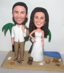 Custom beach theme wedding cake topper