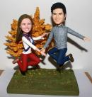 Jumping custom wedding cake toppers