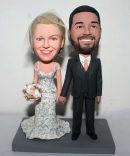 Holding hands custom wedding cake toppers