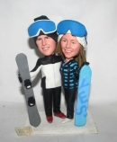 Snowboard couple bobbleheads