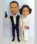 Custom cake toppers Han Solo and Princess Leia