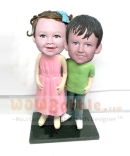 Two children bobbleheads