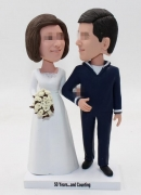 Custom eye to eye wedding bobbleheads