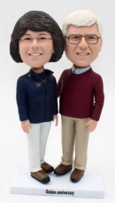 Custom golden anniversay bobbleheads made from photos