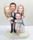 Family of four bobbleheads