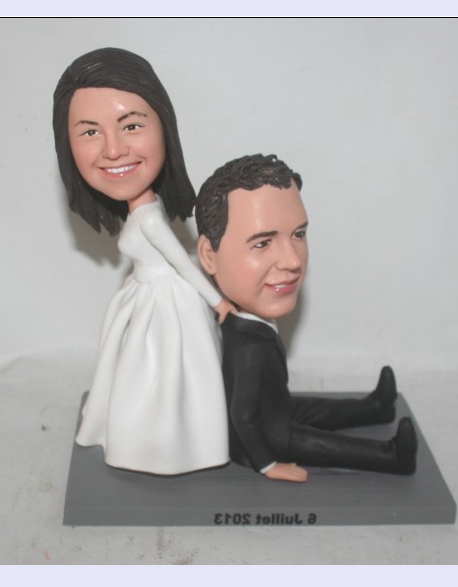 Bride dragging groom cake toppers