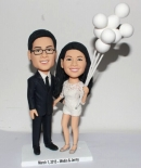 Custom wedding cake toppers with balloons