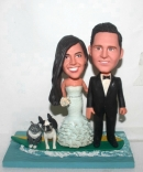 Surfing bobbleheads cake toppers
